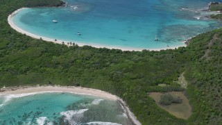 AX102_189 - 5k stock footage aerial video of Turquoise waters and white sand Caribbean beaches bordering trees, Culebrita, Puerto Rico