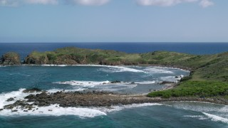 AX102_190 - 5k stock footage aerial video of Waves rolling in toward the coast, Culebrita, Puerto Rico