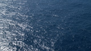 AX102_192 - 5k stock footage aerial video of Sapphire blue ocean waters, Atlantic Ocean