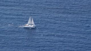 AX102_194 - 5k stock footage aerial video of a Catamaran on blue ocean waters, Atlantic Ocean