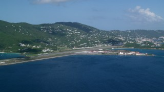 AX102_195 - 5K stock footage aerial video Approaching Cyril E King Airport and coastal homes, St. Thomas