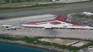 AX102_197 - 5k stock footage aerial video of the Main terminal at Cyril E King Airport, St. Thomas