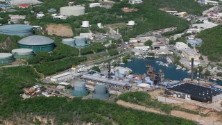 AX102_198 - 5k stock footage aerial video of a Power plant along the water, Charlotte Amalie, St. Thomas