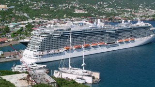 AX102_203 - 5k stock footage aerial video of a Docked cruise ships in a coastal town, Charlotte Amalie, St. Thomas