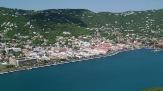 AX102_207 - 5K stock footage aerial video of a Coastal town on a hillside along sapphire waters, Charlotte Amalie, St. Thomas