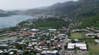 AX102_213 - 5K stock footage aerial video Looking out on a coastal town from the hills, Charlotte Amalie, St. Thomas