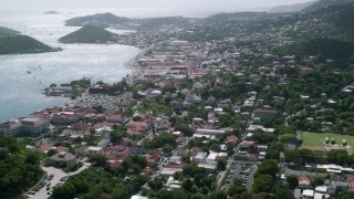 AX102_215 - 5k stock footage aerial video of a Coastal town seen from the hills, Charlotte Amalie, St. Thomas