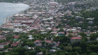 AX102_216 - 5k stock footage aerial video of a Coastal town and Blackbeard's Castle, Charlotte Amalie