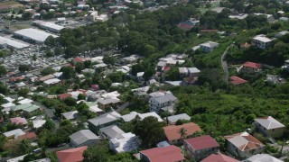 AX102_218 - 5k stock footage aerial video of Hillside homes among trees, Charlotte Amalie, St Thomas