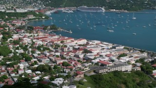 AX102_219 - 5K stock footage aerial video of a Coastal town and sapphire waters with sailboats, Charlotte Amalie, St Thomas