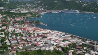 AX102_220 - 5k stock footage aerial video of a Coastal town and sapphire waters with sailboats, Charlotte Amalie, St Thomas