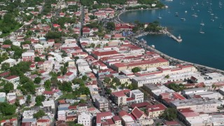 AX102_222 - 5k stock footage aerial video of a Coastal buildings along sapphire blue waters, Charlotte Amalie, St Thomas