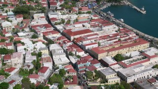 AX102_223 - 5k stock footage aerial video of Coastal buildings along sapphire blue waters, Charlotte Amalie, St Thomas