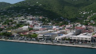 AX102_227 - 5k stock footage aerial video of Coastal buildings and hillside homes, Charlotte Amalie, St Thomas