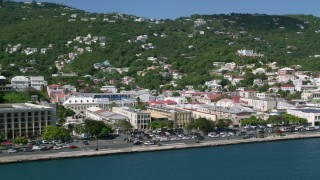 AX102_228 - 5k stock footage aerial video of Buildings along the shore of a coastal town, Charlotte Amalie, St Thomas