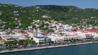 AX102_229 - 5k stock footage aerial video of Buildings along the shore of a coastal town, Charlotte Amalie, St Thomas