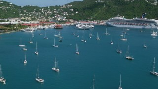 AX102_230 - 5k stock footage aerial video of Sailboats and cruise ship in sapphire blue waters along the coast, Charlotte Amalie, St Thomas