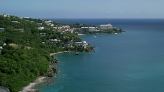 AX102_231 - 5k stock footage aerial video of Marriott's Frenchman's Cove on sapphire blue waters,  St Thomas