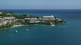 AX102_232 - 5K stock footage aerial video of Marriott's Frenchman's Cove on sapphire blue waters, St Thomas