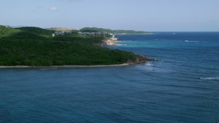AX102_235 - 5k stock footage aerial video of Oceanfront condominiums along sapphire blue waters, Southside, St Thomas
