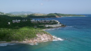 AX102_236 - 5k stock footage aerial video of Oceanfront condominiums on sapphire blue waters, Southside, St Thomas
