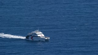 AX102_237 - 5k stock footage aerial video of a Catamaran in blue ocean waters, Southside, St Thomas