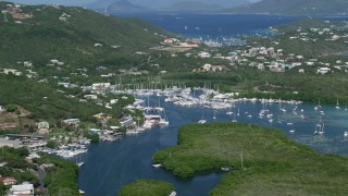 AX102_238 - 5k stock footage aerial video of a Marina with boats in blue ocean waters, Benner Bay, St Thomas