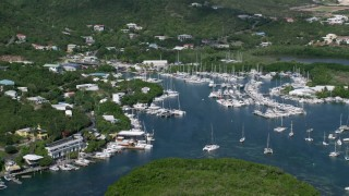 AX102_239 - 5k stock footage aerial video of Boats in a marina, Benner Bay, St Thomas