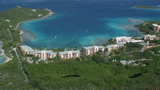 AX102_243 - 5K stock footage aerial video of The Ritz-Carlton resort along turquoise blue waters, St Thomas, US Virgin Islands