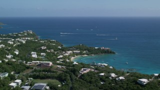 AX102_245 - 5k stock footage aerial video of Secret Harbor Beach Resort resting along turquoise Caribbean waters, St Thomas, US Virgin Islands