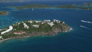 AX102_247 - 5k stock footage aerial video of Hillside oceanfront homes on sapphire blue waters, East End, St Thomas
