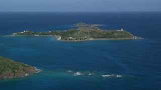 AX102_248 - 5k stock footage aerial video of Little St James Island surrounded by sapphire waters, St Thomas, US Virgin Islands