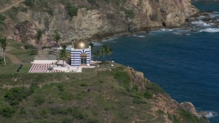 AX102_250 - 5K stock footage aerial video of an Oceanfront gold domed building, Little St James Island