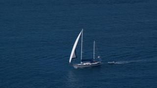 AX102_255 - 5K stock footage aerial video of a Sailboat in sapphire blue waters, St Thomas, USVI
