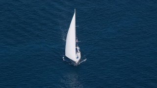 AX102_256 - 5K stock footage aerial video of a Sailboat in sapphire blue waters, St Thomas, USVI