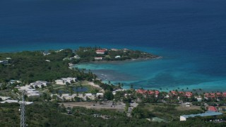 AX102_257 - 5k stock footage aerial video of Condominiums along sapphire blue Caribbean waters, East End, St Thomas