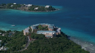 AX102_258 - 5K stock footage aerial video of Sugar Bay Resort and Spa along turquoise blue waters, St Thomas