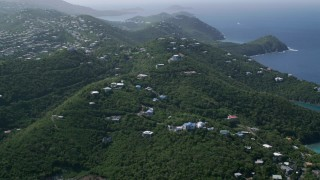 AX102_259 - 5k stock footage aerial video of Hilltop homes over looking the blue ocean waters, East End, St Thomas