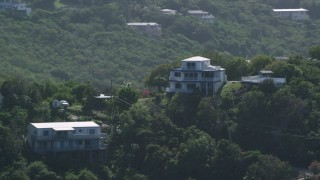 AX102_261 - 5k stock footage aerial video of a Hilltop home surrounded by trees, East End, St Thomas