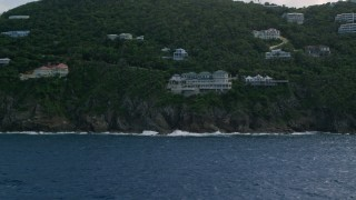 AX102_263 - 5k stock footage aerial video a Hillside mansion looking out at sapphire blue waters, Northside, St Thomas
