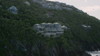 AX102_264 - 5k stock footage aerial video of a Hillside oceanfront mansion with a pool, Northside, St Thomas