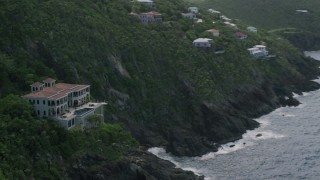AX102_266 - 5K stock footage aerial video of an Oceanfront mansion on a cliff, Northside, St Thomas