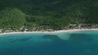 AX102_269 - 5k stock footage aerial video of White sand Caribbean beach and turquoise blue waters, Magens Bay, St Thomas