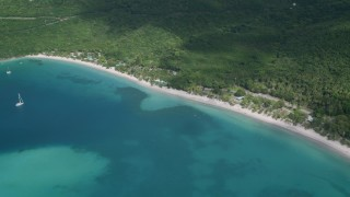 AX102_270 - 5k stock footage aerial video of White sand Caribbean beach along turquoise blue waters, Magens Bay, St Thomas