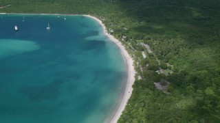AX102_271 - 5K stock footage aerial video of White sand Caribbean beach along turquoise blue waters, Magens Bay, St Thomas