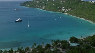 AX102_273 - 5k stock footage aerial video of Sailboats in turquoise Caribbean waters and oceanfront homes, Magens Bay, St Thomas