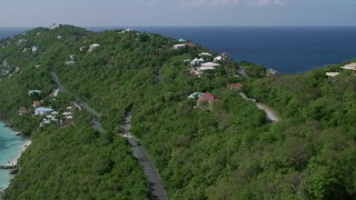 AX102_274 - 5k stock footage aerial video of Oceanfront hillside homes along turquoise Caribbean waters, Magens Bay, St Thomas