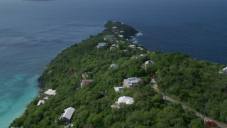 AX102_276 - 5k stock footage aerial video of Hillside oceanfront homes along sapphire blue Caribbean waters, Magens Bay, St Thomas