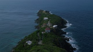 AX102_277 - 5k stock footage aerial video of Oceanfront hillside homes along sapphire blue waters, Magens Bay, St Thomas