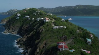 AX102_281 - 5k stock footage aerial video of Hillside oceanfront homes in sapphire blue Caribbean waters, Magens Bay, St Thomas